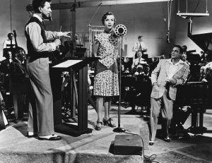 Donald O'Connor, Debbie Reynolds y Gene Kelly en Cantando bajo la lluvia.